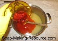 pouring annatto infused oil