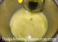 Pouring Comfrey Infused Oil into Soap