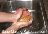 washing hands with annatto seed soap
