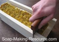 cutting calendula soap