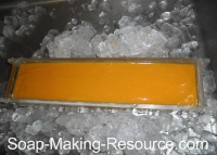 Surrounding the Acrylic Mold with Ice to Keep the Batch Cool