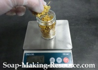 Measuring Calendula Petals into Mason Jar