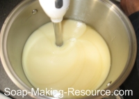 mixing calendula soap with stick blender