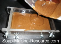 Pouring Soap into Soap Mold