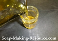 Pouring the Strained Jojoba Oil Back into the Mason Jar