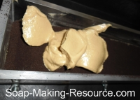 Pouring Second Coffee Soap Layer into Mold