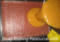 Pouring Soap into Bubble Wrap Lined Mold