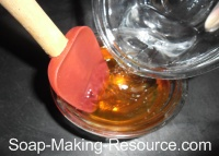 Pouring Water into Honey for Dilution
