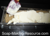 Pouring White Coffee Soap Layer into Mold