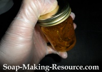 Shaking the Jojoba Oil Ointment Recipe to Mix in the Ingredients