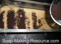 Sprinkling Layer of Coffee Grounds
