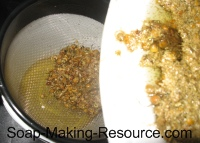 Straining Chamomile Flowers from Olive Oil
