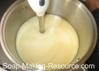 mixing calendula soap with stick blender
