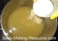 Pouring Almond Milk into Honey Oatmeal Soap