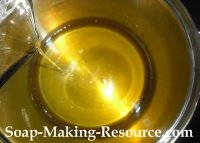 Pouring Liquid Oils into Body Butter Batch