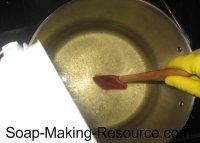 Pouring Lye into Oils