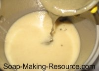 Pouring Small Bentonite Clay Soap Portion Into Rest of Batch