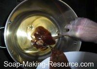 Pouring Walnut Milk Lye Solution into Oils