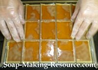 Setting the Divider Set into the Mold to Form Our Bars